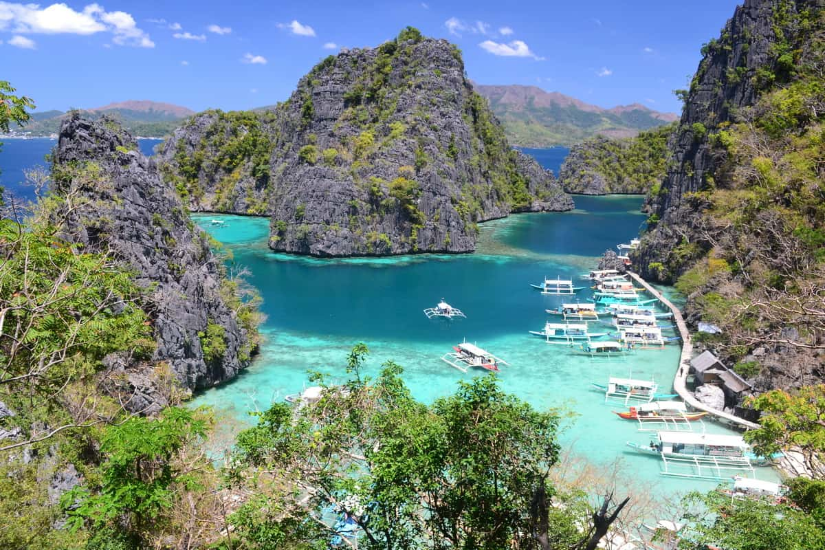 Discover Philippines' Coron Island From El Nido In A Ferry Or On A Boat